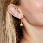 14K Golden Round Pearl Dangling Tincup Earrings - Model Image